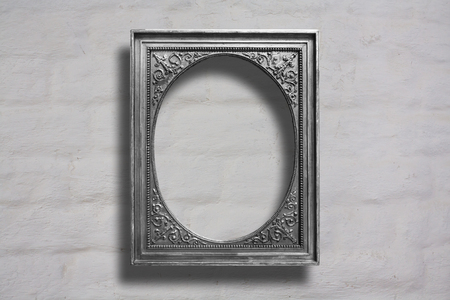 Silver wooden frames for pictures on old brick stone wall