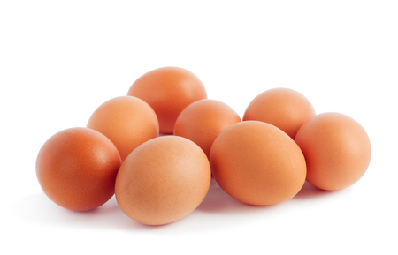 Fresh yellow chicken eggs on white isolated background Stock Photo