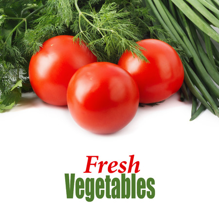 Fresh raw tomatoes, green onions, parsley and dill on white isolated background Stock Photo