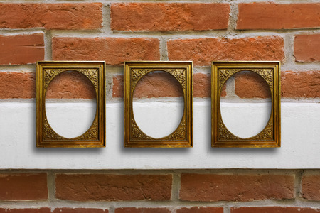 Gilded wooden frames for pictures on old brick stone wall Stock Photo