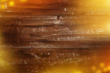 Old wooden background with bright lights and snow for Christmas cards