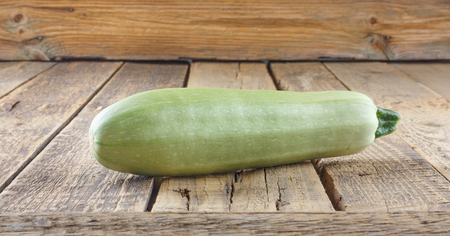 Fresh ripe delicious zucchini on  old wooden table