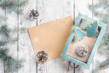 Old box with vintage Christmas handmade toys on  withered wooden background with photo frame. Top view flat lay group objects