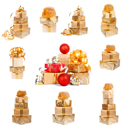 Set of golden festive gift boxes with Christmas balls on white isolated background Stock Photo