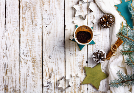 Cup of hot coffee with sugar and cinnamon on old wooden table with spruce branches. Top view flat lay group objects