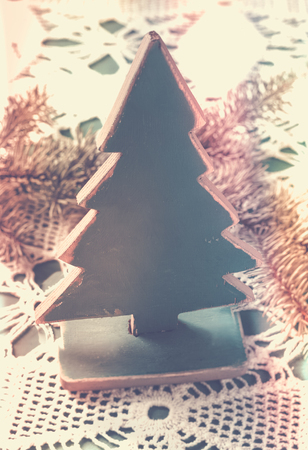 Old vintage wooden Christmas tree with spruce branches