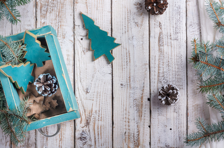 Old box with vintage Christmas handmade toys on a withered wooden background. Top view flat lay group objects