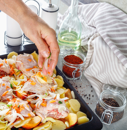 Hand of man take cooking of meat with vegetable and  spices for grill.  Cooking  kitchen ingredients on table.