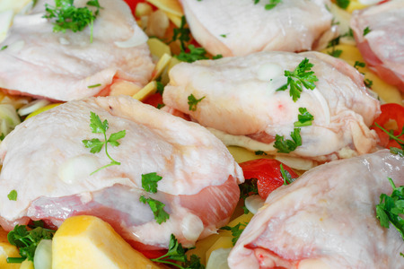 Delicious raw chicken with fresh vegetables, fruits and spices for baking tray