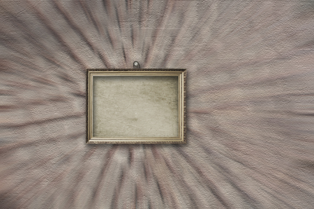 Wooden vintage silver victorian frame for museum exhibition on old, worn gray wall Stock Photo