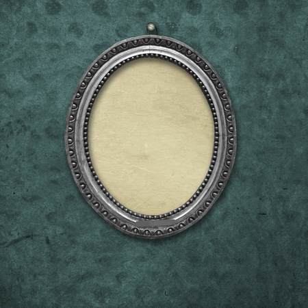 Wooden vintage silver victorian tondo frame for museum exhibition on old, worn green wall