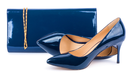 Beautiful  blue shoes with clutches on white isolated background Фото со стока