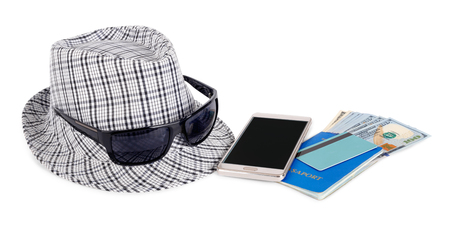 Hat, money, phone, glasses, credit card for travel on white isolated background. Фото со стока