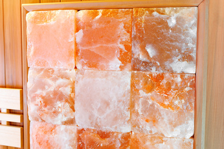 Interior dry Himalayan salt sauna wall.  Sauna room at  spa hotel