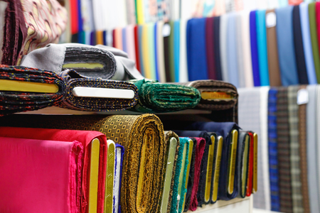 Various multicolored  fabrics for sale in  textile store Stock Photo