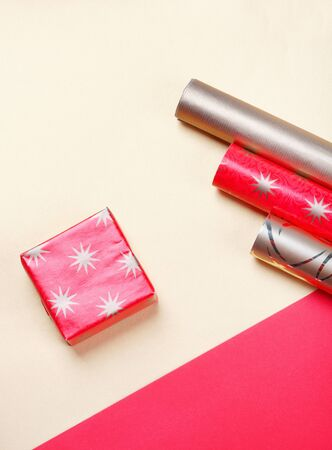 Golden gift boxes and red wrapping paper on bright background.Top view flat lay group objects