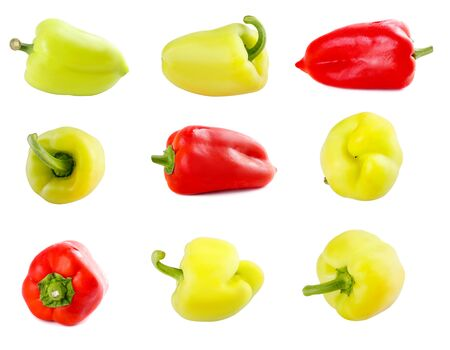 Set of fresh raw yellow red and green peppers on  white isolated background