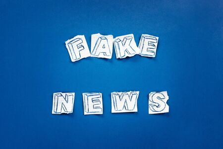 Paper art banner on blue backdrop in style zine wiht words fake news. Social media concept.
