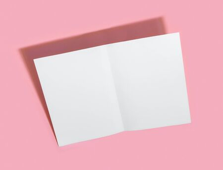 Empty white paper sheet for text on pink background.  Presentation Form.
