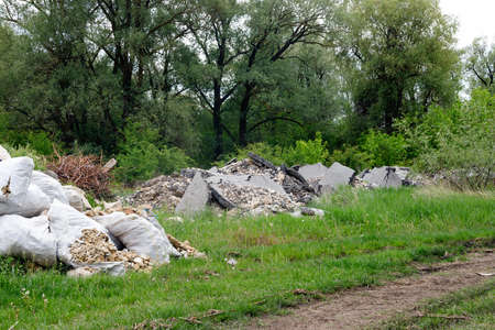 Dump of construction and household garbage in the forest.Environmental pollution. Foto de archivo - 155232912