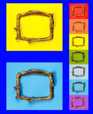 Multicolored wooden frames in rustic style on bright, lue wall. Beautiful collection on light background. Rainbow concept