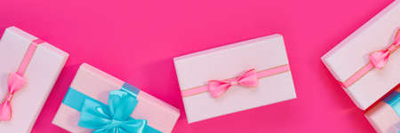 Banner from set of beautiful gift boxes with blue bows on pink background. Holiday sale. Copy space for your text. Flat lay, top view, copy space concept. Foto de archivo - 155232935