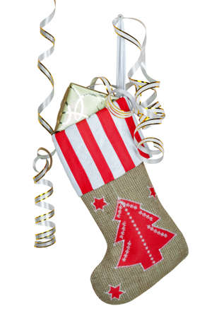Red christmas boot with gifts on white isolated background