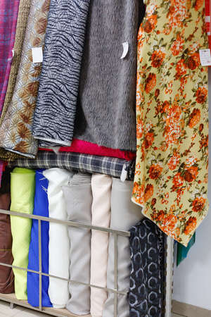 Various multicolored fabrics for sale in textile store