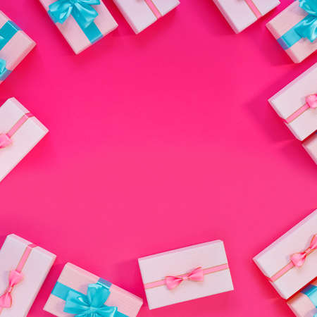 Set of beautiful gift boxes with blue bows on pink background. Holiday sale. Copy space for your text. Flat lay, top view, copy space concept. Foto de archivo