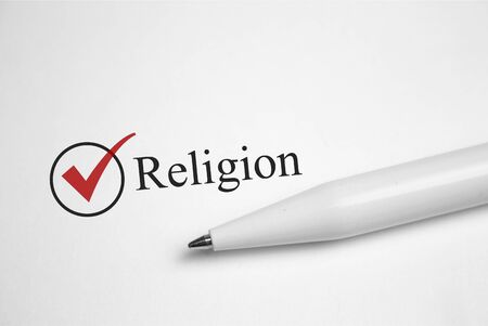 Religion. Filling in the questionnaire, documents. The checkboxes are filled with a red pen on a white background. Questionnaire