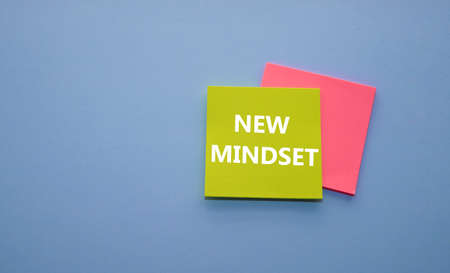 new mindset and new results concept - colorful sticky notes on a background of crumpled white notes. 免版税图像 - 151114597