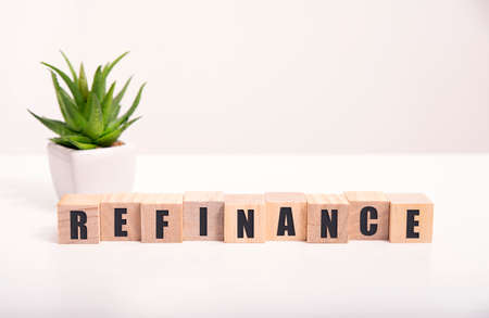focus on wooden blocks with letters making Refinance text