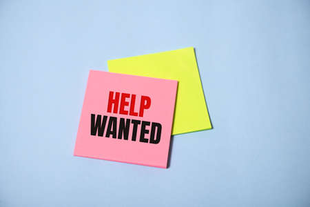 Help Wanted Sign on stickers on blue background