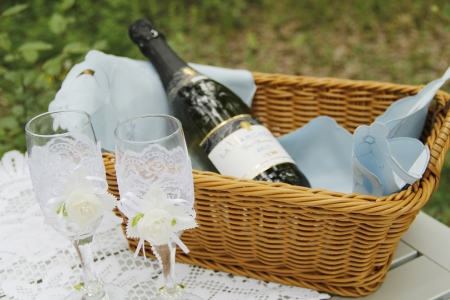 A pair of wedding glasses and basket. Photo taken on: June 02th photo