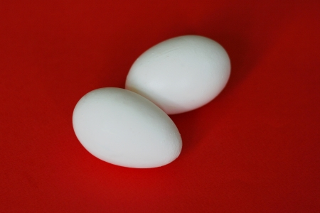 ova: Two eggs on the red background Stock Photo