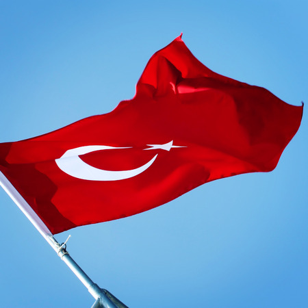Turkish Flag on the blue sky. 免版税图像