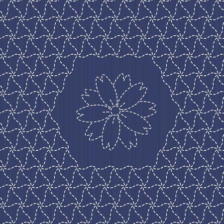 桜の花と伝統的な日本刺繍飾り。