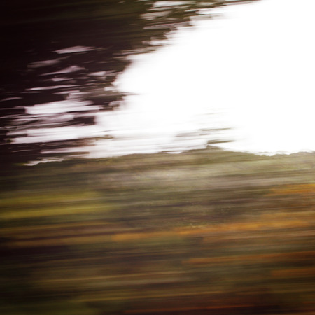 vague: Defocused trees viewed through a car windscreen - vintage effect. Blurred action from car at high speed. Vague view through moving car window. Ring of Kerry, Ireland.