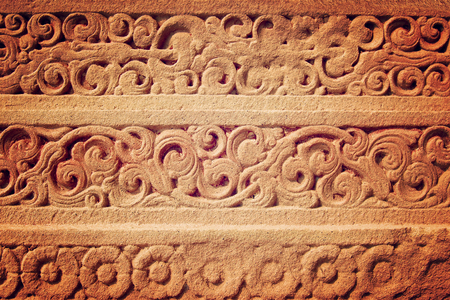 engravings: Ancient wall with engravings  - vintage effect. Asian carved stone decoration - retro filter. Stock Photo