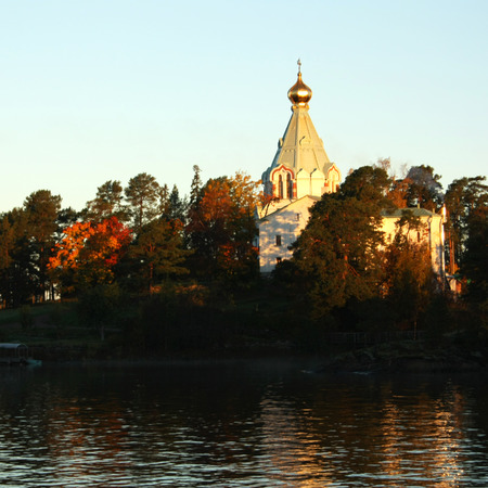 Saint Nicholass church on the island (skete). Valaam island on the Ladoga lake. Aged photo. Beautiful churches. Nikolsky monastery. Nicholas The Wonderworkers church. Karelya, Russia.