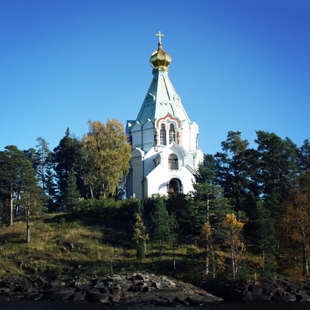 Nikolsky monastery. Nicholas The Wonderworkers church. Saint Nicholass church on the island (skete). Valaam island on the Ladoga lake. Aged photo. Beautiful churches. Karelya, Russia.