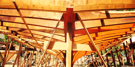 Building a boat. Under construction. Toned photo. The wooden keel beams. Orange wood. Colorful image. Traditional methods. Turkey. Imagens - 78307285