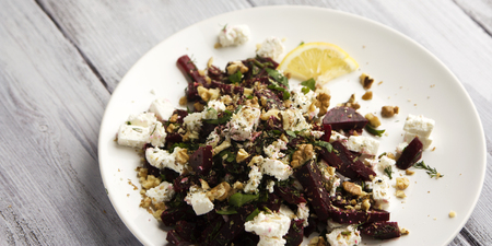 Beetroot salad with cottage cheese and walnuts. European cuisine. Organic food. Vegetarian appetizer. Simple side dish. Wide photo.