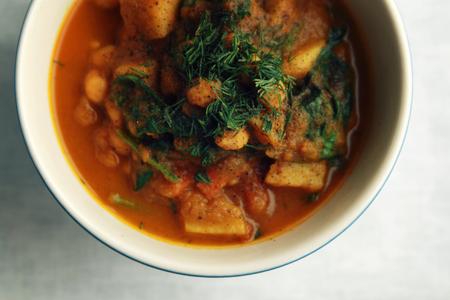Simple vegetable soup. European cuisine. Chickpeas, potato and carrot. Organic food. Vegan dish. Vegetarian lunch. Top view.