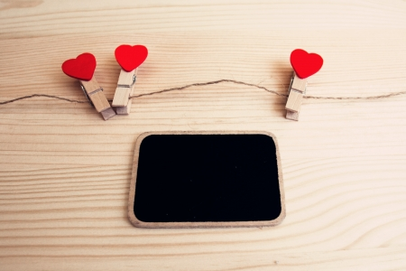 A black board and a string of red hearts