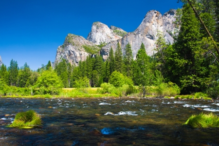 Three Brothers Rock and Merced River in Yosemite National Park, California photo