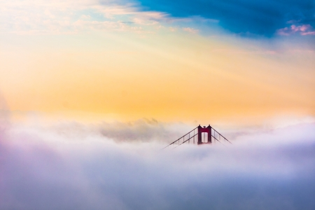 World Famous Golden Gate Bridge Surrounded by Fog after Sunrise in San Francisco,California