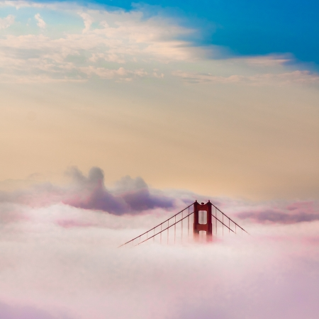 san: World Famous Golden Gate Bridge Surrounded by Fog after Sunrise in San Francisco,California