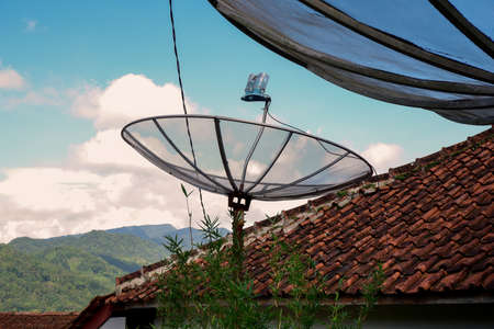 parabolic tv broadcasts in the countryside with a beautiful natural blue sky background