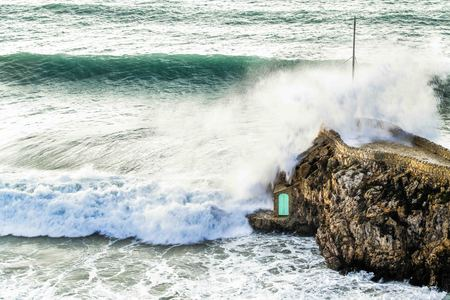 Waves breaking on the rocks during a storm